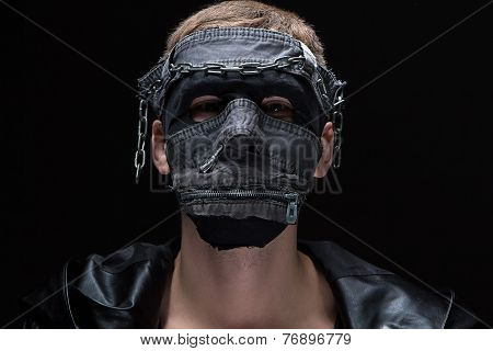 Photo of madman in handmade mask