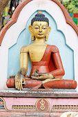 Baby monkey in Buddha statue hands, swayambhunath, Nepal poster
