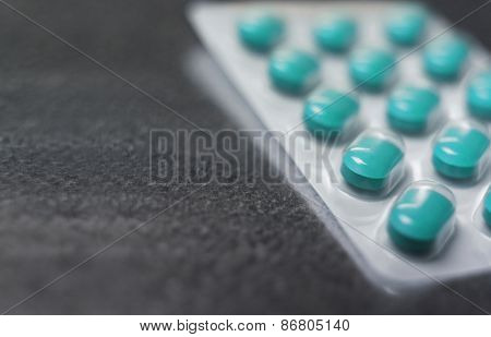 Blister pack of Turquoise medicine pills Close up