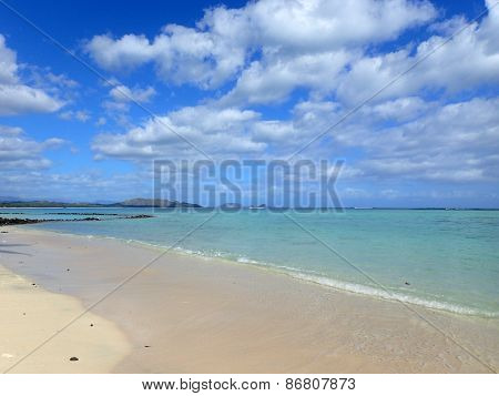Beach Next To Pahonu Pond (ancient Hawaiian Fishpond) With Shallow Wavy Ocean Waters Of Waimanalo Ba