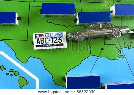 Car With License Plate On Texas State Map