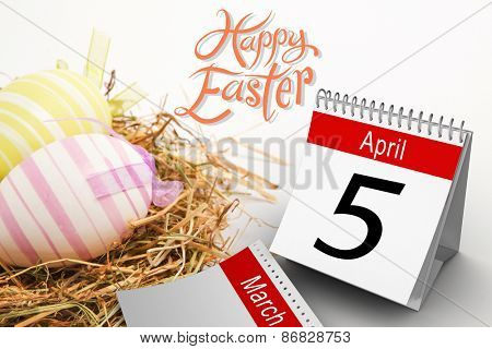 five against two easter eggs in straw