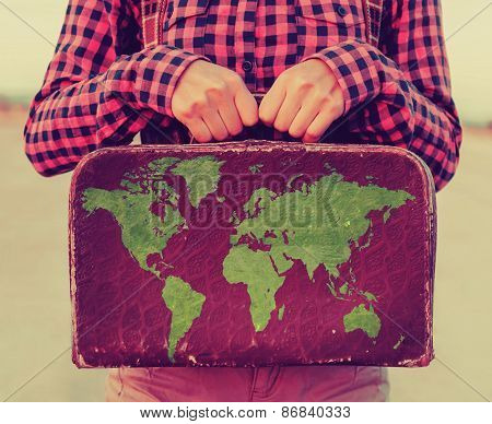 Woman Holding A Small Suitcase