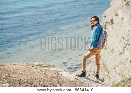 Traveler Girl Walking On Coast In Summer
