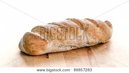 Loaf Of Whole Wheat Bread Isolated On White. Home Made Organic Crunchy Tasty Healthy Bread Sitting O