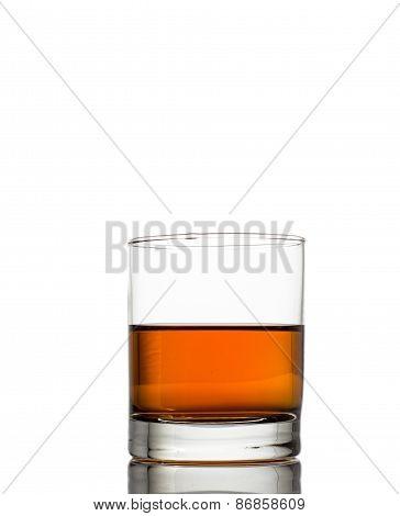 Isolated shot of whiskey with splash on white