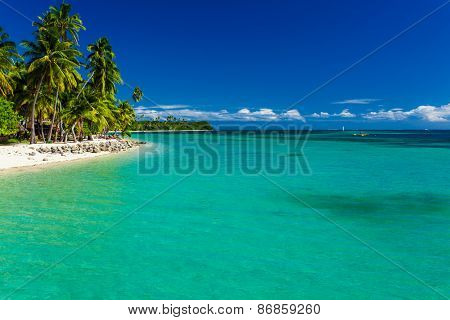 Tropical island in Fiji with sandy beach and pristine water