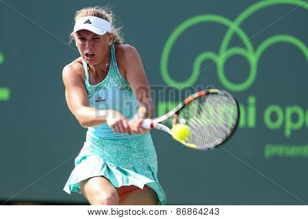 KEY BISCAYNE, FL-MAR 26: Caroline Wozniacki of Denmark returns a shot during day four of the Miami Open at Crandon Park Tennis Center on March 26, 2015 in Key Biscayne, Florida.