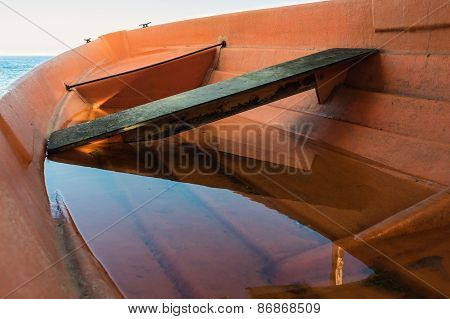 Orange Boat Filled With Water