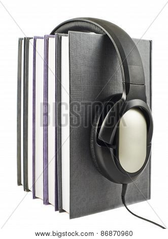 Books with a headphones on isolated
