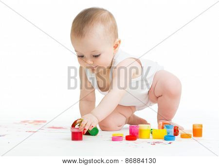 baby painting by hands