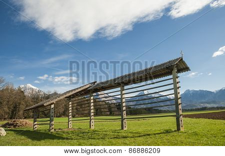 Hayrack on meadow in gorenjska region, Slovenia poster