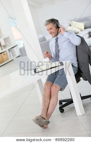 Businessman on video meeting from home in relaxed outfit