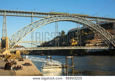 PORTO, PORTUGAL - CIRCA FEB, 2015: Famous Dom Luis I Bridge at Ribeira in Porto, Douro river and Old Town. In 1996, UNESCO recognised Old Town of Porto as a World Heritage Site.