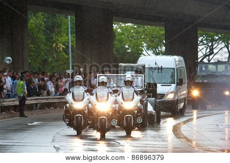 SINGAPORE MARCH 29:Motorcade leading gun carriage bearing the coffin of ex prime minister of Singapore, Mr Lee Kuan Yew driving pass on rainy day of state funeral Mar 29 Singapore 2015