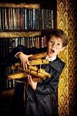 A boy stands in the library by the bookshelves with many old books and holds old manuscripts. Educational concept. Science. Vintage style. poster