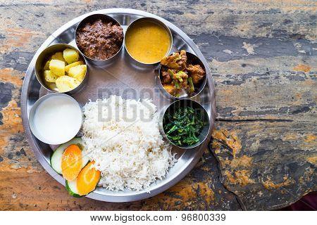 Sumptous Nepali Thali meal set with mutton