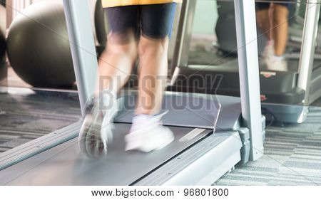 Unknow Woman Running With Motion With Treadmill