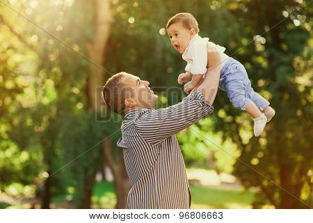 Daddy Playing Active Games With His Son Outside