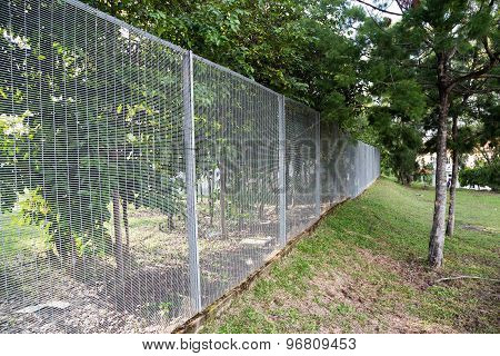 Security fencing with surveillance camera at residential neighborhood