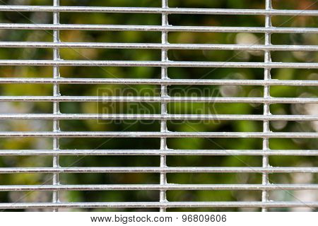 BRC Fence for security with de-focused greenaries background