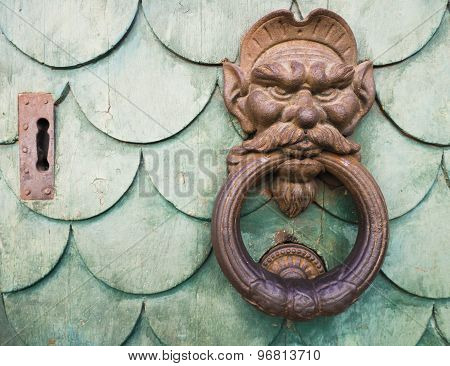 Iron goblin face doorknocker