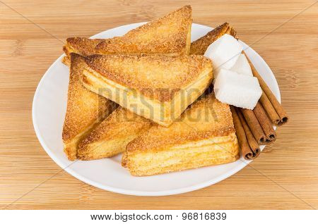 Sweet Puff Pastries, Pieces Of  Lumpy Sugar And Cinnamon Sticks