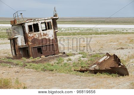 Rusted remains of fishing boat at the sea bed of the Aral sea Aralsk, Kazakhstan.