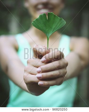 Smiling Woman Holding Ginkgo Biloba Leaf I