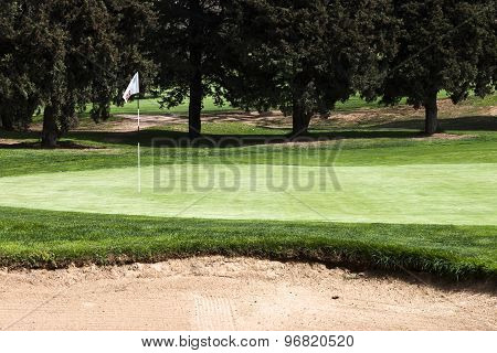 15 Th Hole Flagstick On A Putting Green In A Golf Course.