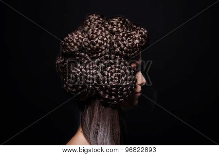 Side view of beautiful fashion model with a creative hairstyling