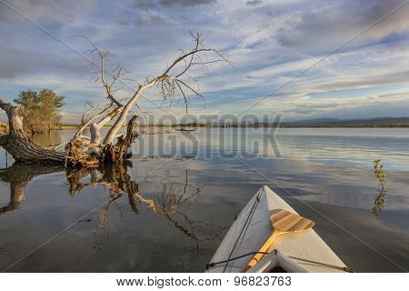 wide angle view from a canoe on a calm lake  - Lonetree Reservoir near Loveland, Colorado