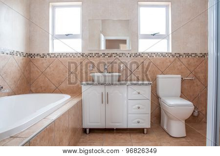New Bathroom With Bath, Basin, And Toilette