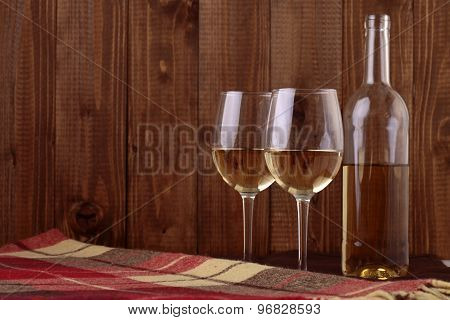 Bottle And Wine Glasses On Plaid