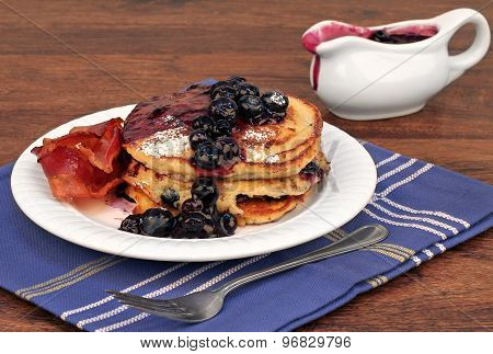 Homemade Pancakes With Fresh Blueberry Sauce And Bacon.
