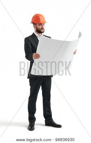 serious businessman in orange hardhat looking at blueprint. isolated on white background