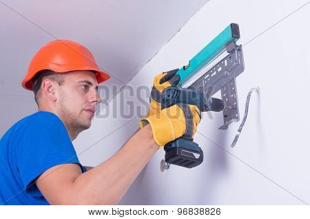 Air conditioning master preparing to install new air conditioner. poster