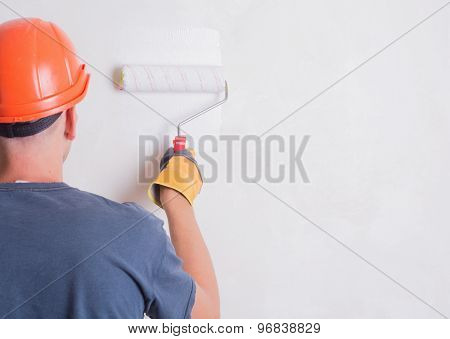 Painter On Stepladder Painting Wall With Brush poster