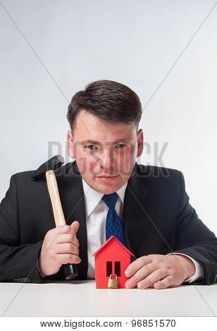 Businessman with hammer