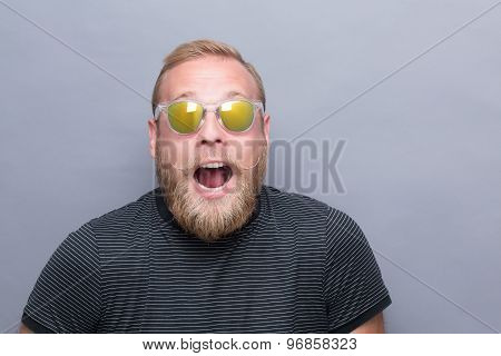 Surprised bearded man in sunglasses