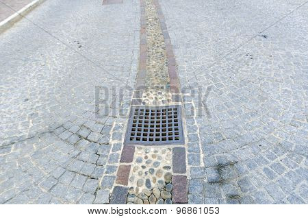 Street paved with square stone pavement