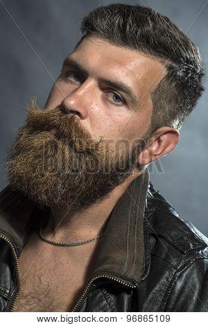 Portrait Of Sullen Unshaven Man