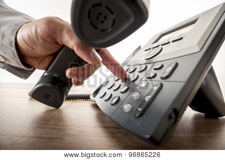 Global Communication Concept - Closeup Of Male Hand Dialing A Telephone Number In Order To Make A Ph