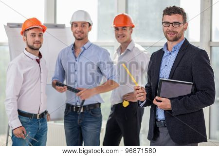Young construction crew in the process of work