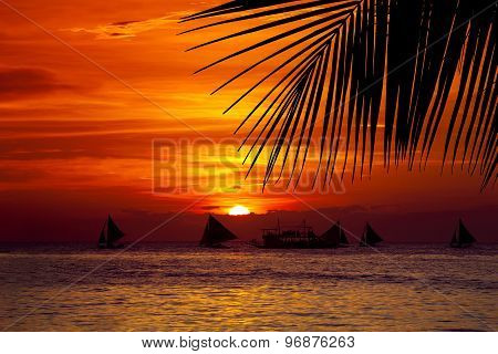Sunset On Beach With Sailing Boats