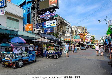 Bangkok, Thailand - July 25, 2015: Tourists Walk Along Backpacker Haven Khao San Road And Tuktuk Aro
