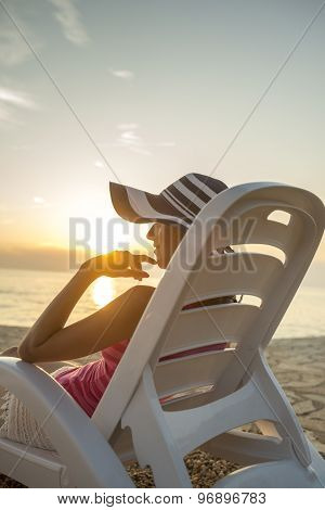 Woman Relaxing On A Tropical Beach