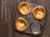 close up of rustic golden british yorkshire pudding poster