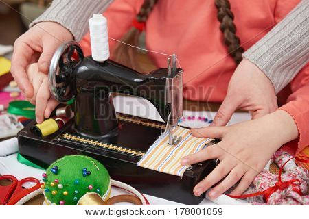 mother teaching daughter girl sew, job training, handmade and handicraft concept