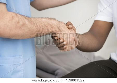 Male Doctor And Patient Shaking Hands After CT Scan